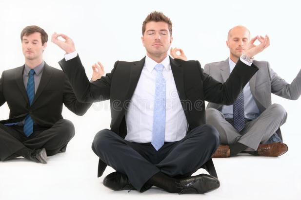 businessman-meditating-white-21958039